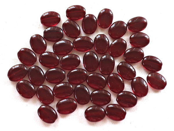 25 transparent garnet red flat oval Czech Glass beads, 12mm x 9mm pressed glass beads C9425 - Glorious Glass Beads