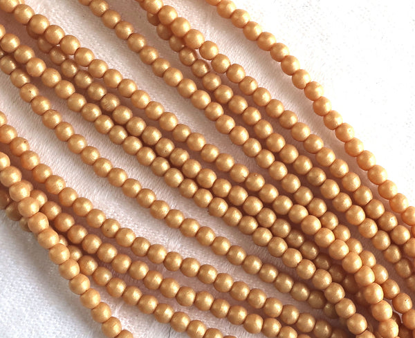Lot of 100 3mm Czech glass druks, opaque beige, yellow / gold Pacifica Ginger smooth round druk beads C7750