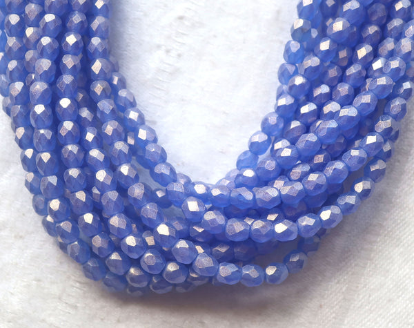 Lot of 50 4mm Czech glass beads, Sueded Gold Sapphire Blue firepolished, faceted beads. with a golden finish C9601