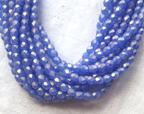 Lot of 50 4mm Czech glass beads, Sueded Gold Sapphire Blue firepolished, faceted beads. with a golden finish C9601 - Glorious Glass Beads
