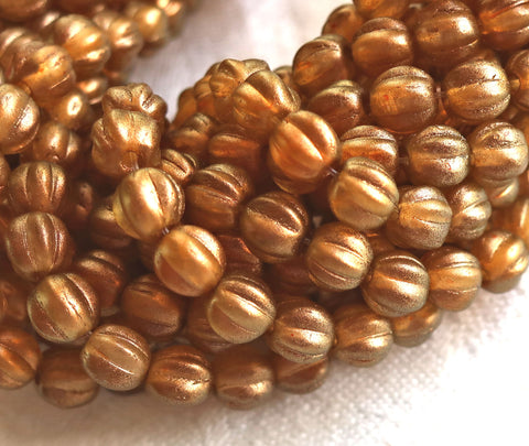 Lot of 50 5mm Czech glass melon beads, Halo Samdalwood, orange, sienna or burnt umber with a golden glow C51150