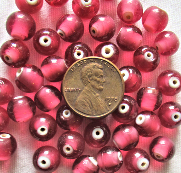 lot of 25 raspberry pink glass oval beads with white hearts - approx 8 x 9mm - Made in India, C1801