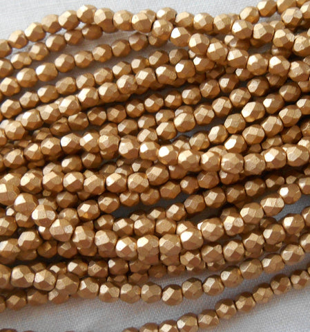 50 3mm Matte Metallic Gold Flax Czech glass beads, firepolished, faceted round beads C7550 - Glorious Glass Beads
