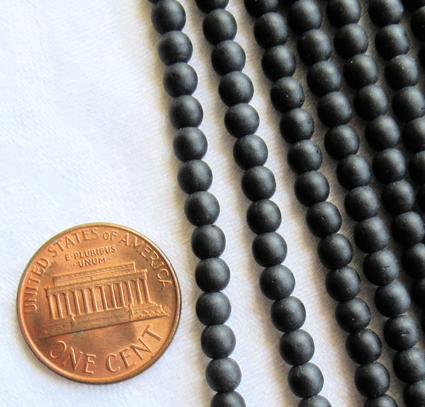 Lot of 100 4mm matte jet black Czech glass druks - smooth round druk beads C7601 - Glorious Glass Beads