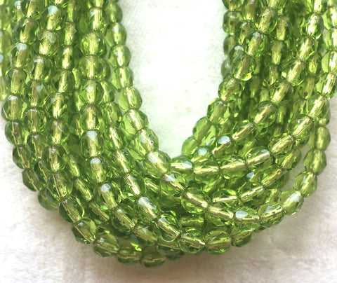 Lot of 50 4mm Czech glass beads, olive. olivine green, silver lined, firepolished faceted round beads C5550