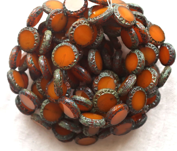Six Czech glass coin beads, 12mm disc beads, table-cut carved Aztec, Mayan sun rustic, earthy translucent orange, smustard picasso 05101 - Glorious Glass Beads