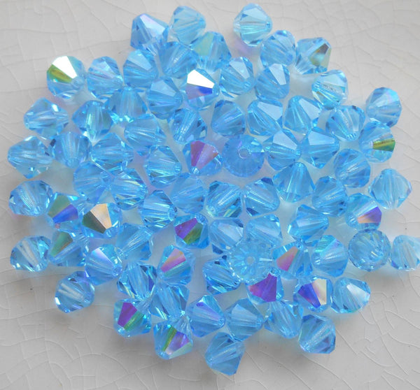 Lot of 24 6mm Aqua, Aquamarine AB Czech Preciosa Crystal bicone beads, faceted glass blue AB bicones C50101 - Glorious Glass Beads