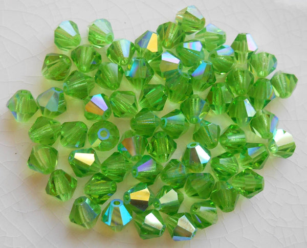 Lot of 24 6mm Peridot Green AB Czech Preciosa Crystal bicone beads, faceted glass green AB bicones C60101