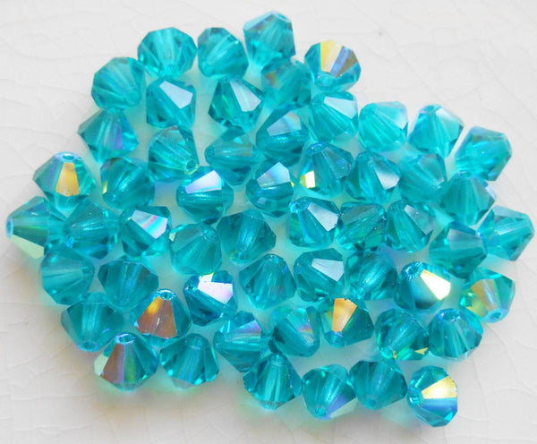 Lot of 24 6mm Blue Zircon AB AB Czech Preciosa Crystal bicone beads, faceted glass blue AB bicones C60101 - Glorious Glass Beads