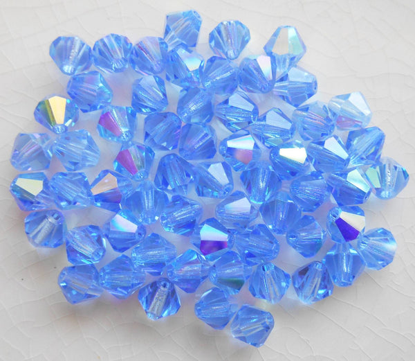 Lot of 24 6mm Sapphire Blue AB Czech Preciosa Crystal bicone beads, faceted glass blue AB bicones C60101 - Glorious Glass Beads