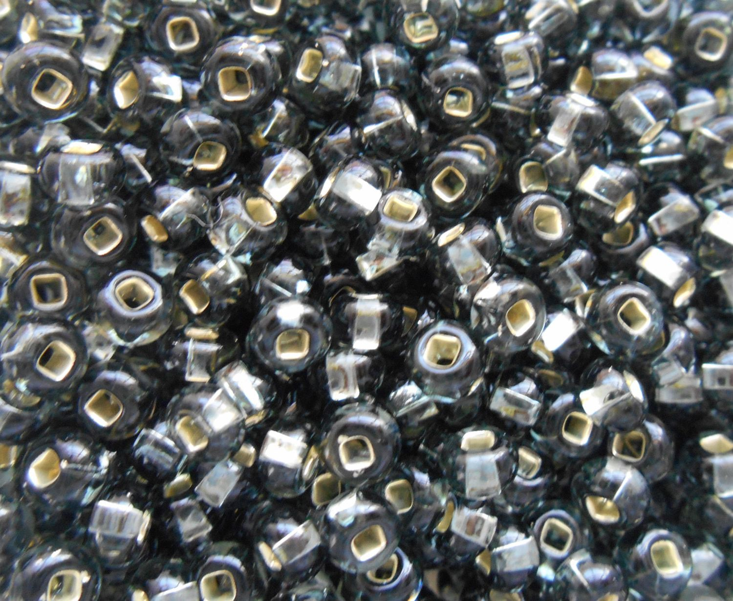 pkg of 24 grams black diamond silver lined czech 60 large glass seed beads