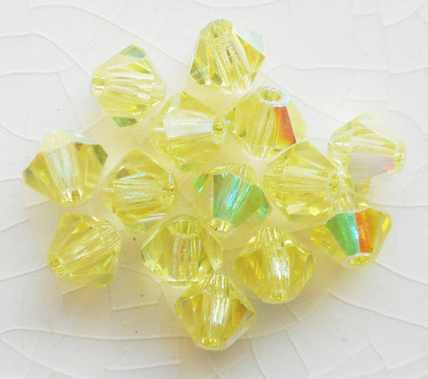 Lot of 24 4mm Czech Preciosa Crystal Jonquil AB glass faceted bicone beads, yellow AB bicones 2701 - Glorious Glass Beads