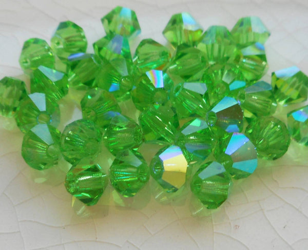 Lot of 24 4mm Czech Peridot AB glass faceted bicone beads, Preciosa Green AB bicones 5601 - Glorious Glass Beads