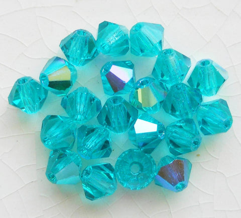 Lot of 24 4mm Blue Zircon AB Czech Preciosa Crystal bicone beads, faceted glass blue AB bicones C5601 - Glorious Glass Beads