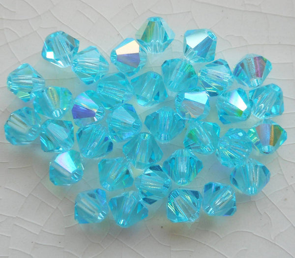 Lot of 24 4mm Aqua blue AB Czech Preciosa Crystal bicone beads, faceted glass blue AB bicones C5601