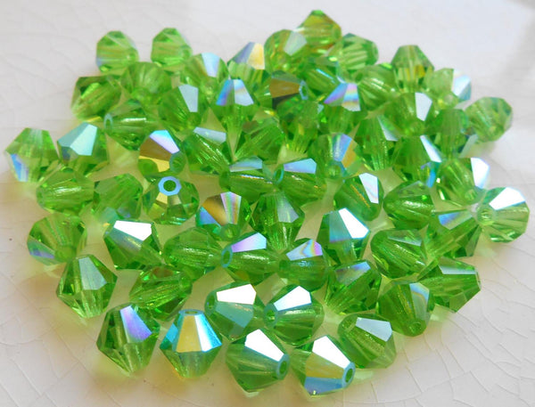 Lot of 24 6mm Peridot Green AB Czech Preciosa Crystal bicone beads, faceted glass green AB bicones C60101 - Glorious Glass Beads