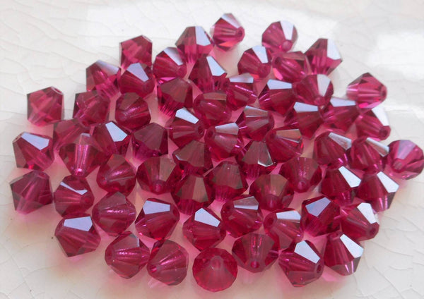 Lot of 24 6mm Fuchsia Czech Preciosa Crystal bicone beads, faceted glass bright pink bicones C4801