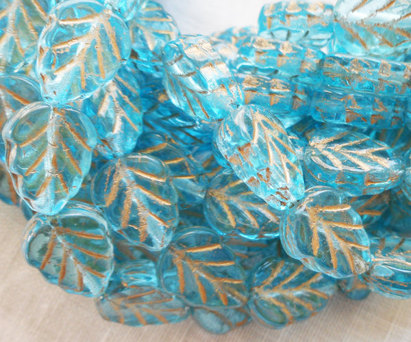 Lot of 25 Czech glass leaf beads, transparent aquamarine blue with gold accents center drilled 8 x 10mm beads C56101