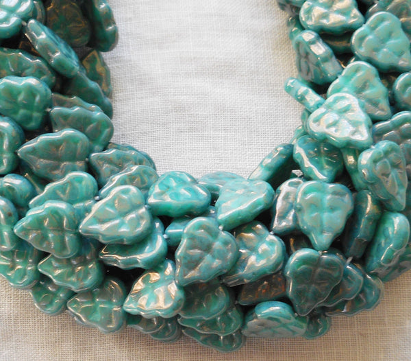 Lot of 25 Czech glass leaf beads, Luster Opaque Turquoise Blue center drilled 8 x 10mm beads C67101 - Glorious Glass Beads