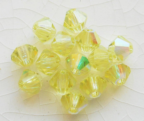 Lot of 24 4mm Czech Preciosa Crystal Jonquil AB glass faceted bicone beads, yellow AB bicones 2701