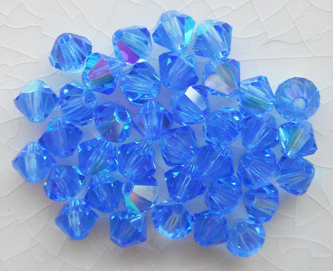 Lot of 24 4mm Sapphire Blue AB Czech Preciosa Crystal bicone beads, faceted glass blue AB bicones C5601 - Glorious Glass Beads