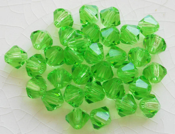 Lot of 24 4mm Czech Peridot Green glass faceted bicone beads, Preciosa Green bicones 2501