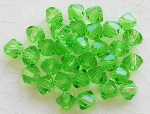 Lot of 24 4mm Czech Peridot Green glass faceted bicone beads, Preciosa Green bicones 2501 - Glorious Glass Beads