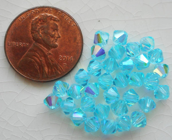Lot of 24 4mm Aqua blue AB Czech Preciosa Crystal bicone beads, faceted glass blue AB bicones C5601 - Glorious Glass Beads