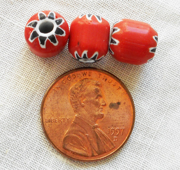 Ten large red chevron glass beads with a black and white pattern on the ends 8 x 9mm C4601 - Glorious Glass Beads