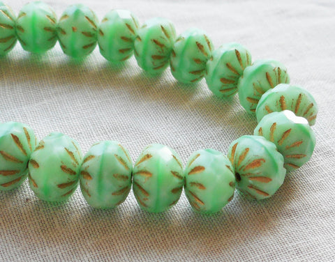 Lot of 25 6 x 9mm Czech opaque mint green with gold accents, faceted carved cruller beads, Czech glass rondelles 08301