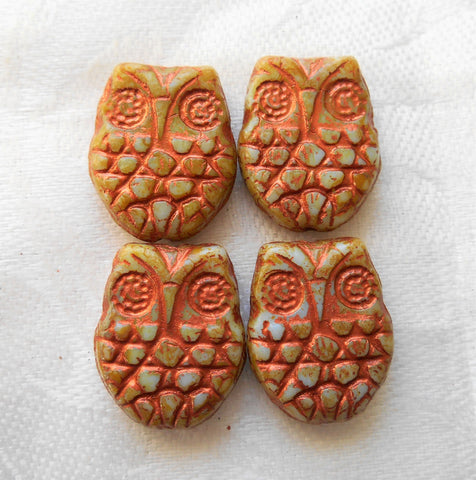 Four large blue & brown, copper, or rust Czech glass owl beads, opaque blue picasso glass with a brown, copper wash 18mm x 15mm C00101