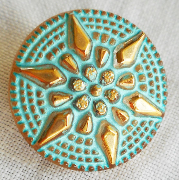 One 18mm Czech glass button, with a gold raised star with a turquoise wash, verdigris look decorative shank button 05201