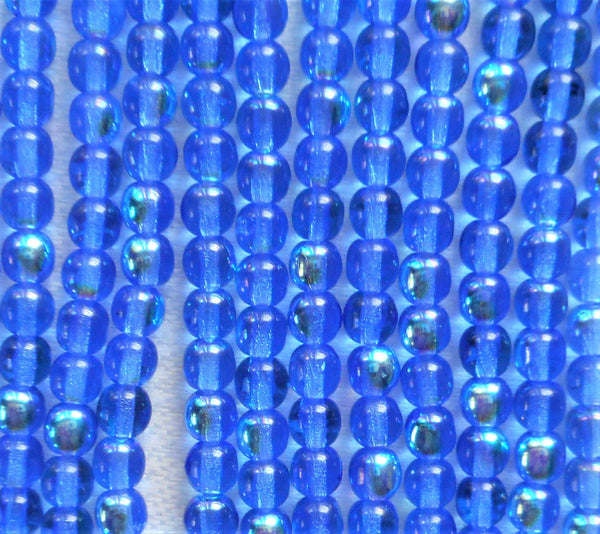 Lot of 100 4mm Sapphire Blue AB Czech glass druk beads, blue AB smooth round druks, C7601 - Glorious Glass Beads