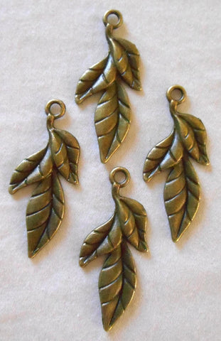 Two antique bronze leaf charms, pendants, 39m by 11mm , three metal leaves C6102