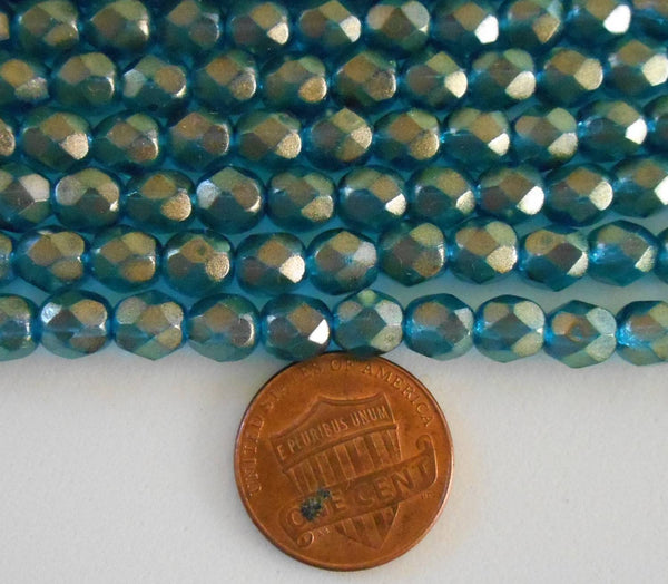 Lot of 25 6mm Halo Azurite Czech, firepolished, aqua glass over gold faceted round beads, C5525