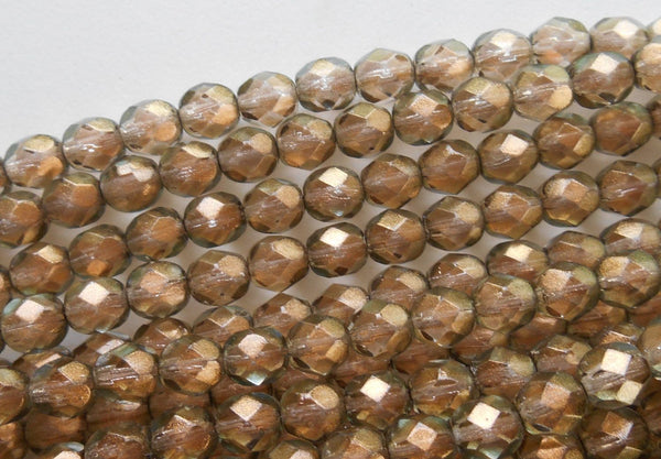 Lot of 25 6mm Halo Linen Czech, Green glass over Gold firepolished, faceted round beads, C2925 - Glorious Glass Beads