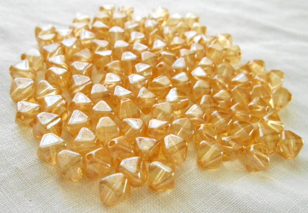 Fifty 6mm Crystal Champagne bicones pressed glass Czech bicone beads, C5350
