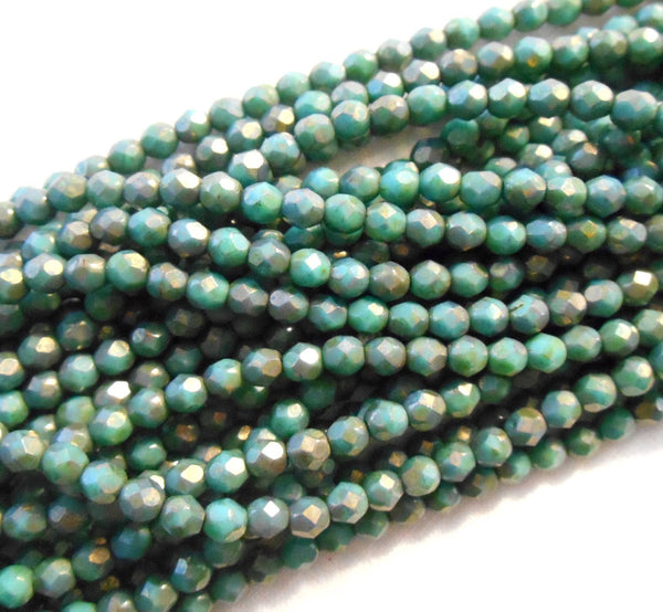 Fifty 4mm Turquoise Copper Picasso Czech glass firepolished, faceted round beads, C1650