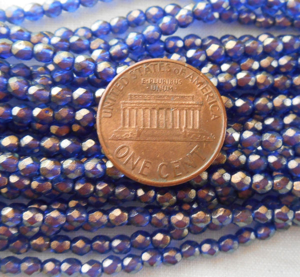 Fifty 3mm Halo Ultramarine Blue Czech glass over gold, firepolished, faceted round beads, C7750 - Glorious Glass Beads