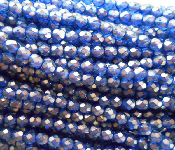 Lot of 25 6mm Halo Ultramarine blue glass, firepolished, faceted round beads with a gold finish, C5525 - Glorious Glass Beads