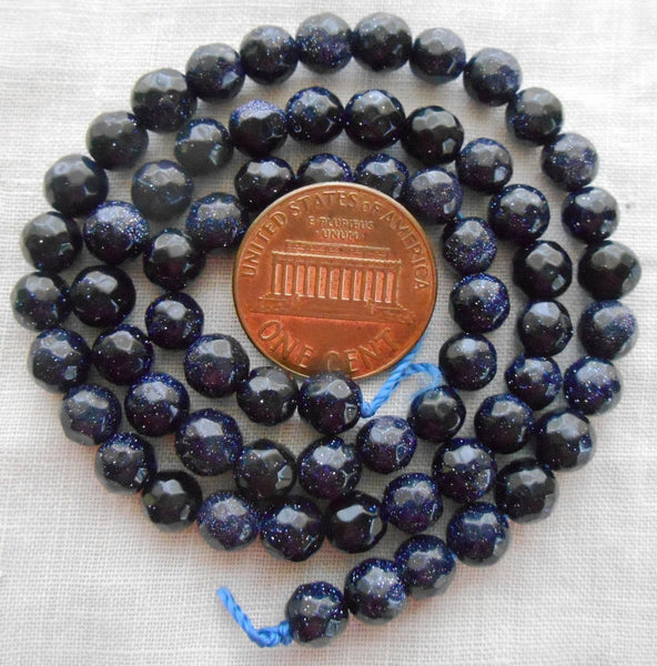 Lot of 66 6mm blue goldstone, faceted, round, gemstone beads, 14.5 inch strand, C12366 - Glorious Glass Beads