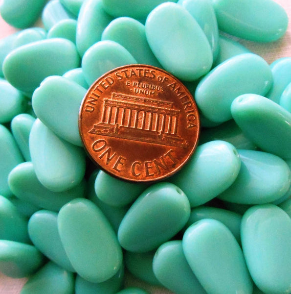 Lot of 25 Opaque Turquoise slightly twisted oval Czech pressed Glass beads, 14mm x 8mm, 03125