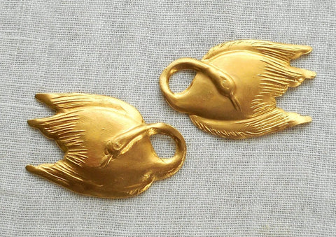 "Two raw brass swan, swans, pendants, charms, brass stampings, 1"" in by .625"" in. made in the USA6301"