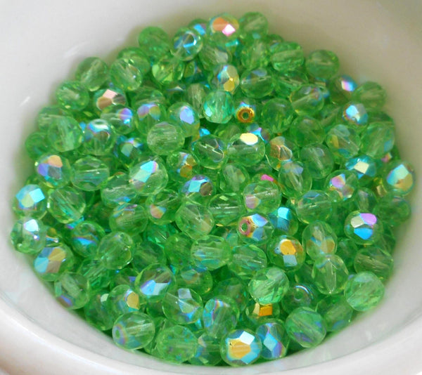 Lot of 25 6mm Mint Green AB, faceted round firepolished glass beads, C6425 - Glorious Glass Beads
