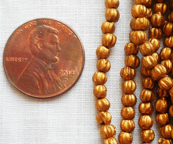 Lot of 100 3mm Matte Metallic Antique Gold melon beads, Czech pressed glass beads C61150 - Glorious Glass Beads
