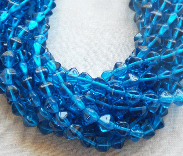 Fifty 6mm Capri Blue bicones, pressed glass Czech bicone beads, C8550