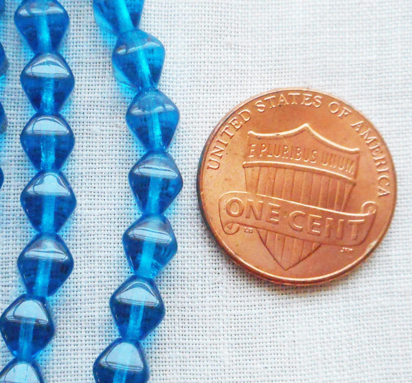 Fifty 6mm Capri Blue bicones, pressed glass Czech bicone beads, C8550 - Glorious Glass Beads