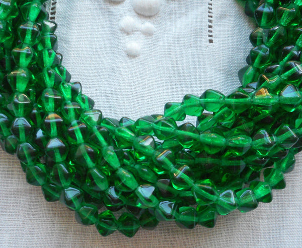 Fifty 6mm Emerald Green bicones, pressed glass Czech bicone beads C5501