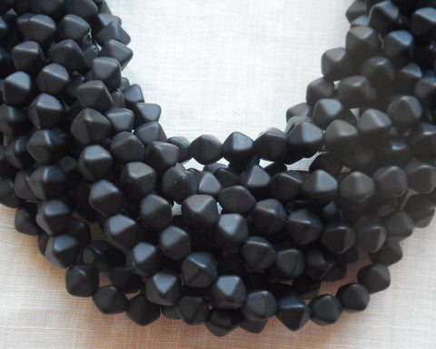 Fifty 6mm Matte Black bicones, pressed glass Czech bicone beads C7401 - Glorious Glass Beads