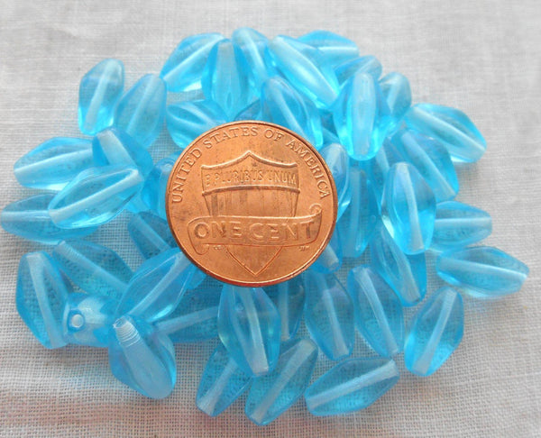 Lot of 25 11mm x 7mm Aqua Blue Czech glass lantern or tube beads, C9125 - Glorious Glass Beads